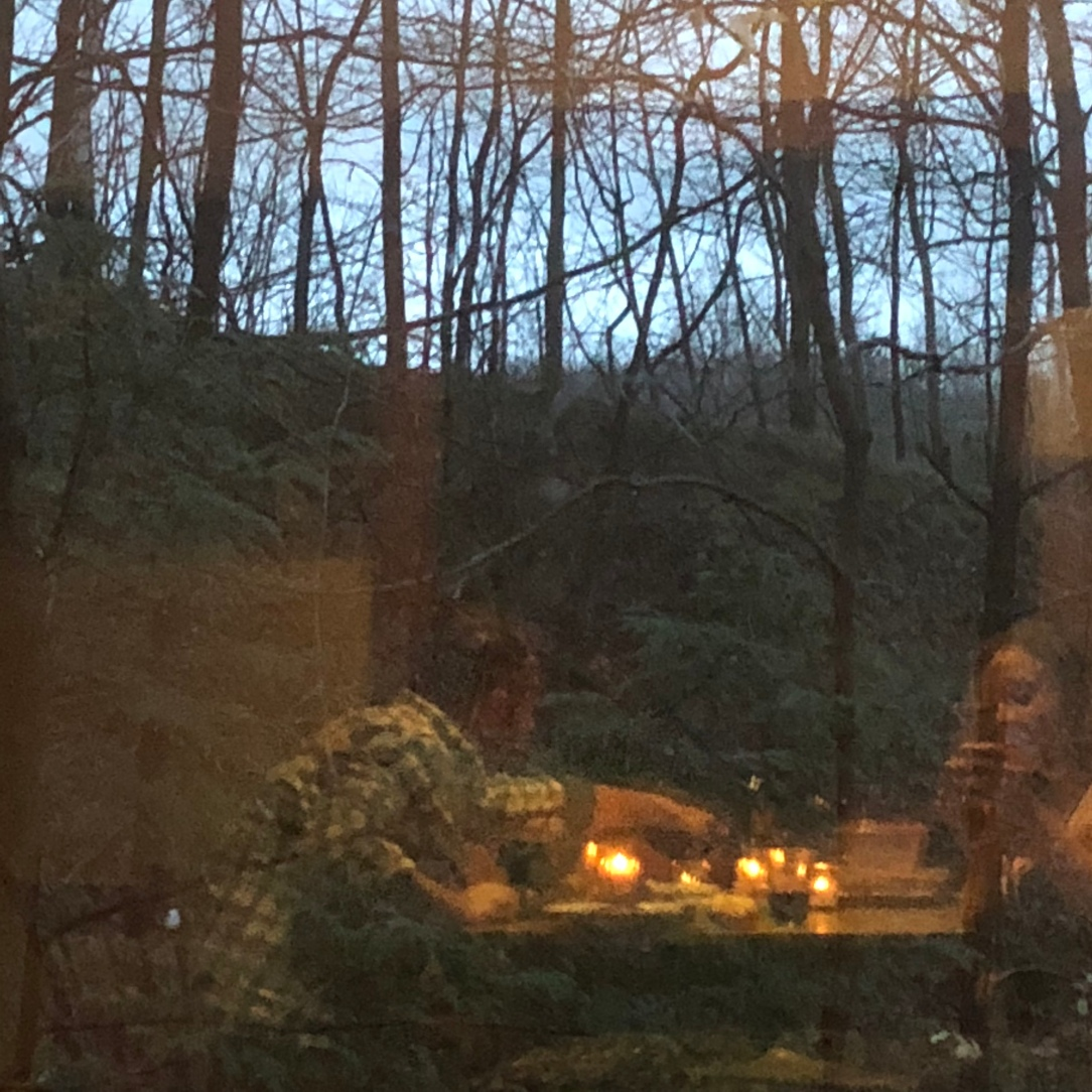 Reflection of candlelit dinner for two